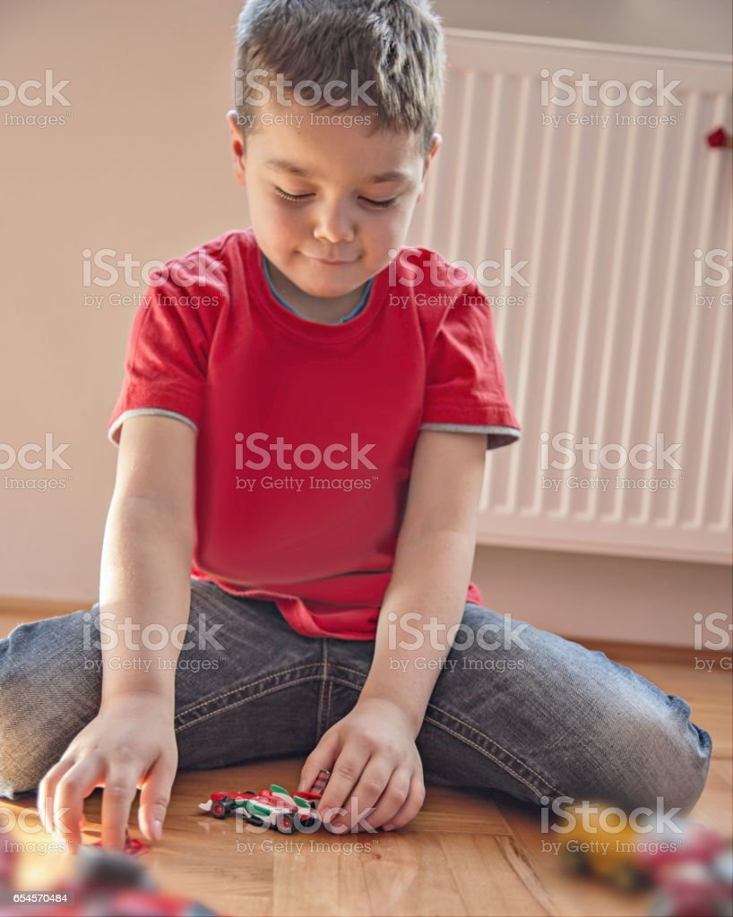 Little boy playing with car toys stock photo