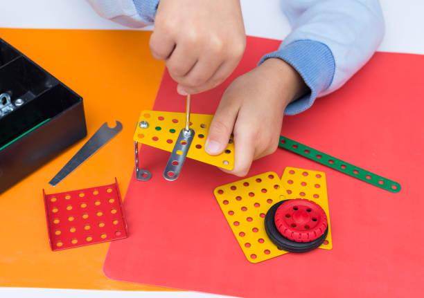 Little boy playing with Educational metal construction kit stock photo