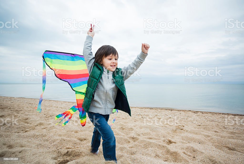 Little boy playing with kite stock photo