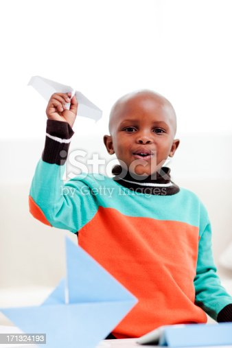 istock Little boy playing with paper airplane 171324193