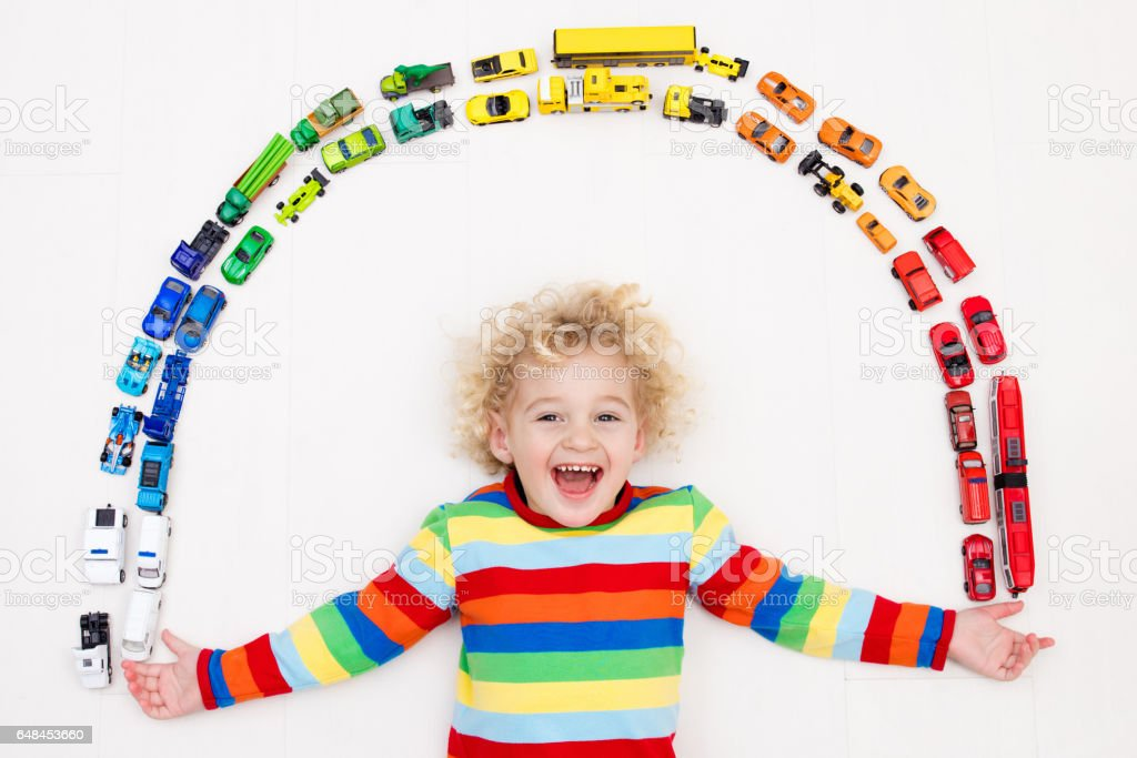 Little Boy With Toy Car : Little boy playing with toy cars toys for kids stock photo