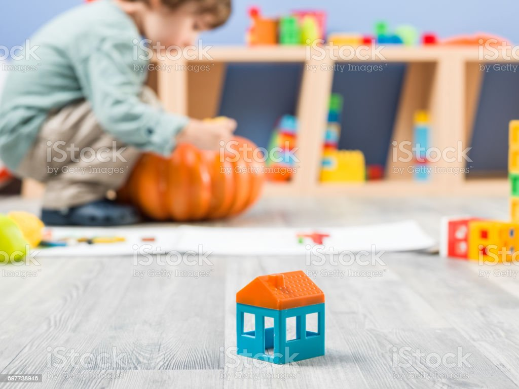 Little Boy Playing With Toys In Kindergarten Stock Photo More