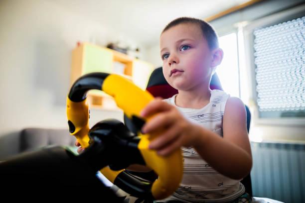 Little boy plays  race  games