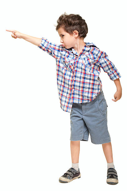 Little boy pointing away stock photo