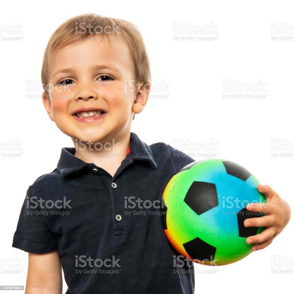 Little boy posing holding his soccer ball stock photo