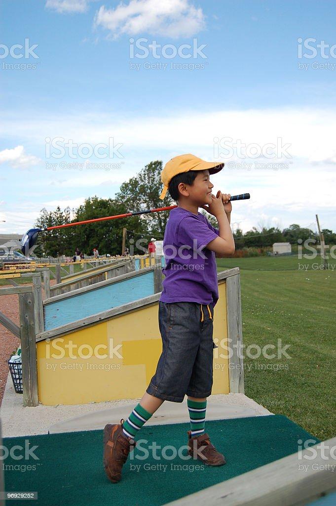 Little boy practicing golf shot royalty-free stock photo