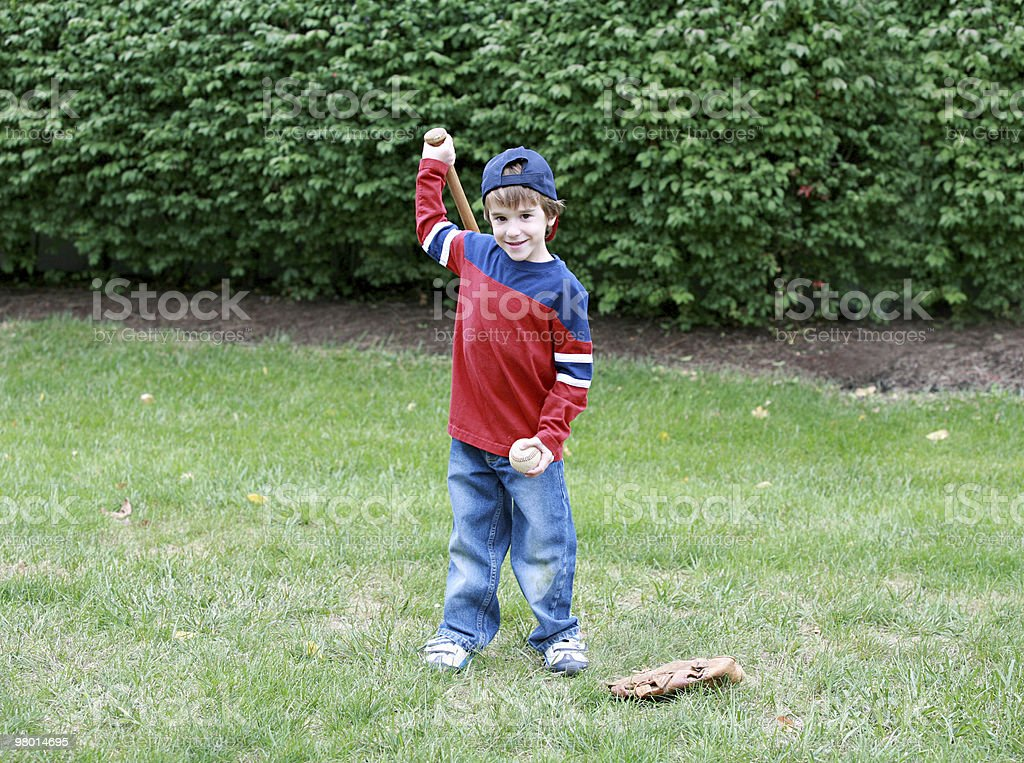 Little Boy Practicing His Baseball royalty-free stock photo