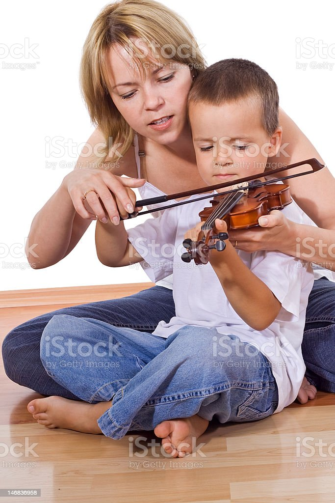 Little boy practicing the violin royalty-free stock photo