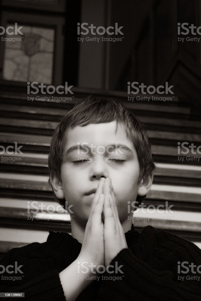 Little Boy Praying, Black and White royalty-free stock photo