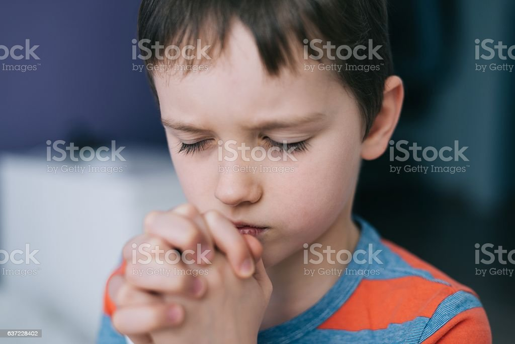 Little boy praying. Boy's prayer. stock photo
