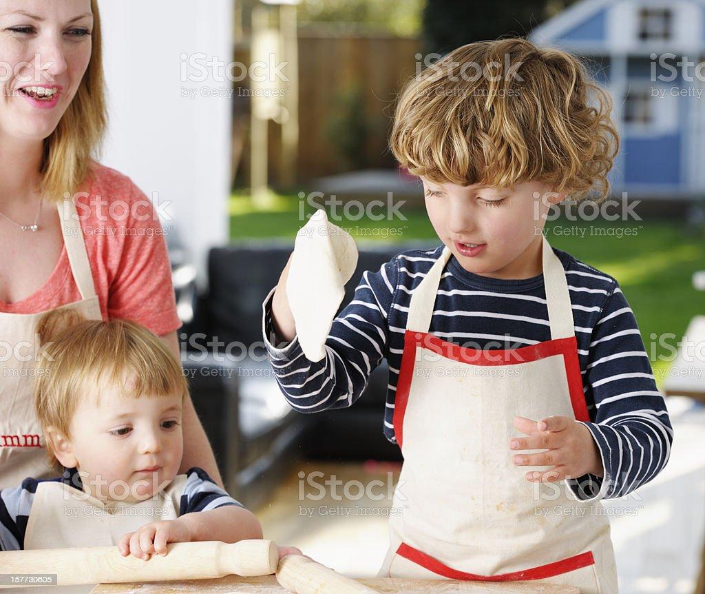 Little Boy Preparing Pizza Dough royalty-free stock photo