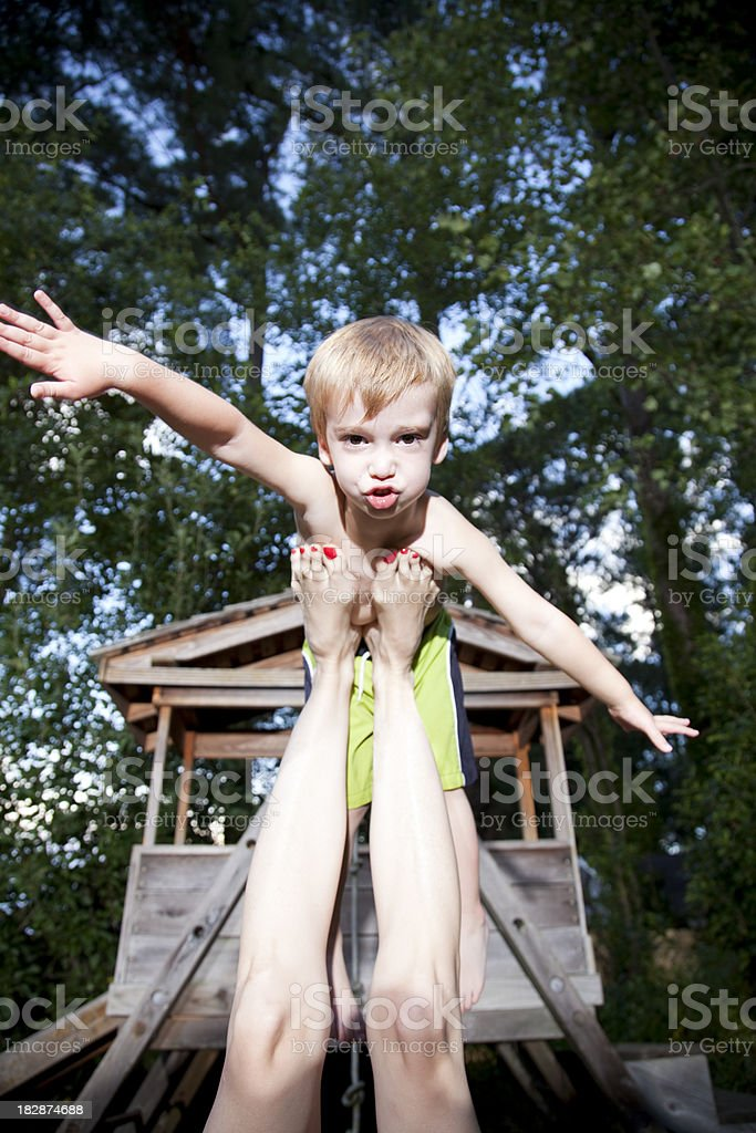 Little boy pretending to fly royalty-free stock photo