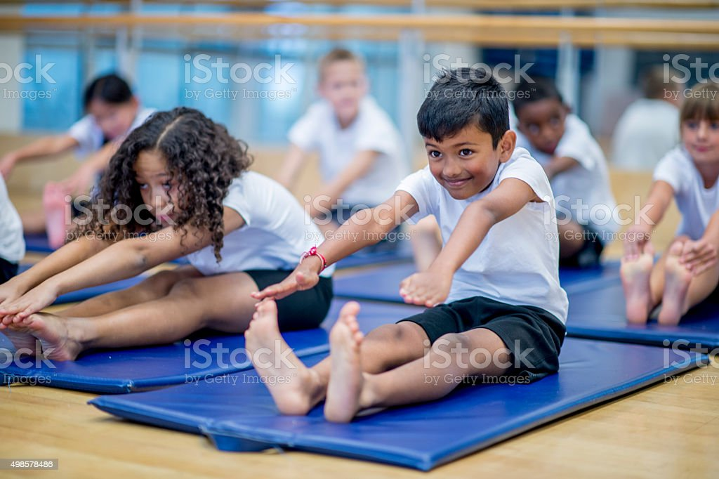 Little Boy Reaching for His Toes stock photo