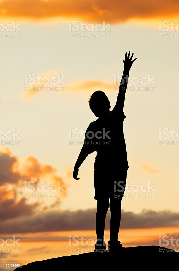 Little Boy Reaching For The Sky (Tiptoe) - II royalty-free stock photo