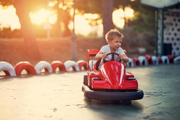 Little boy riding a funfair bumper car picture id687957998?b=1&k=6&m=687957998&s=612x612&w=0&h=0j7klqqr5vavlhr44v2agjg7gyus irqm5a nswf3xq=