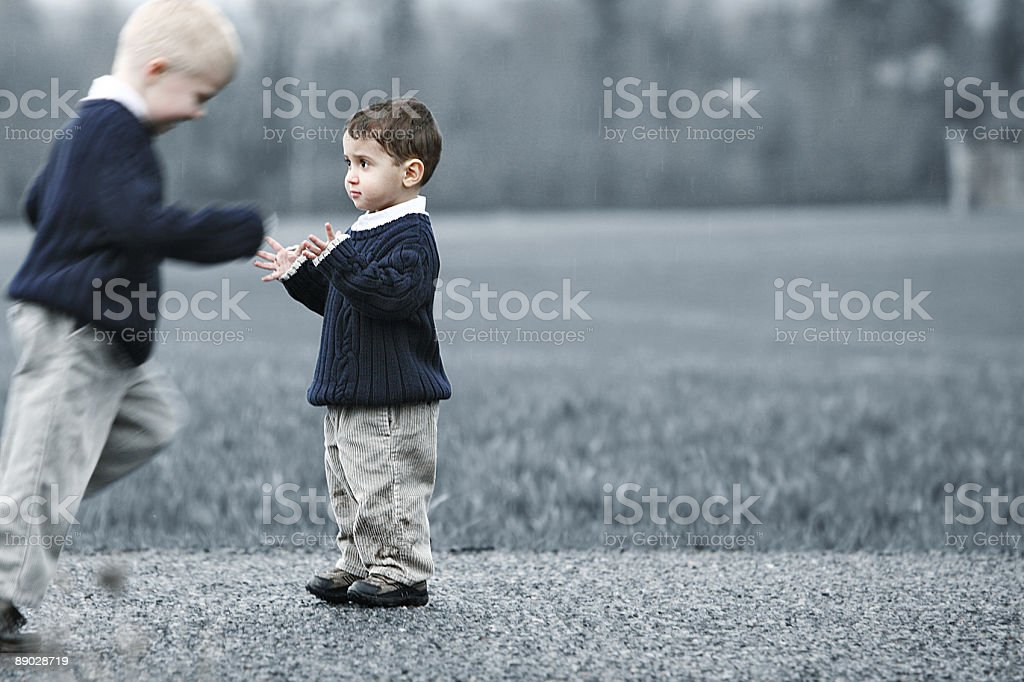Little Boy Running and Feeling the Rain royalty-free stock photo