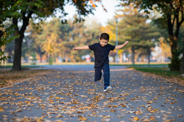 Little Boy Running and Jumping Outdoor – Foto