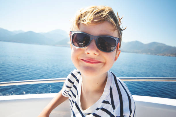Little boy sailing stock photo