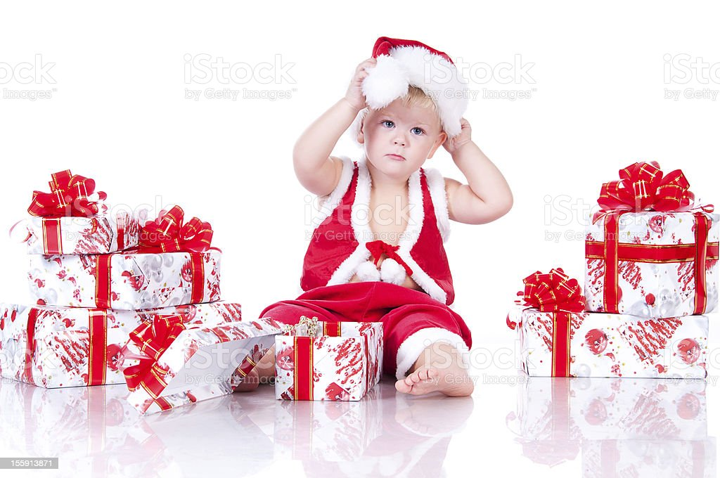 Little boy Santa Claus with Christmas gifts. royalty-free stock photo