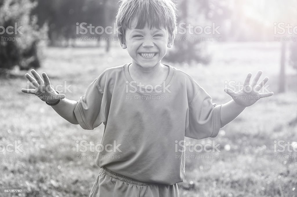 little boy scaring people with their hands Lizenzfreies stock-foto