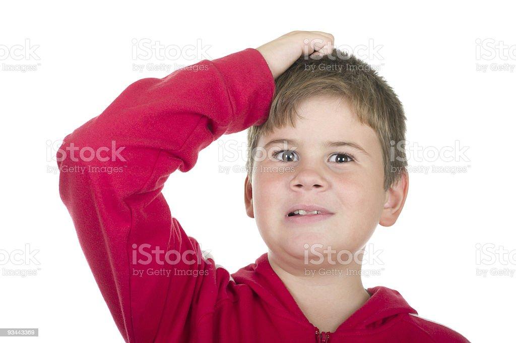 Kleine Junge kratzt Kopf Lizenzfreies stock-foto