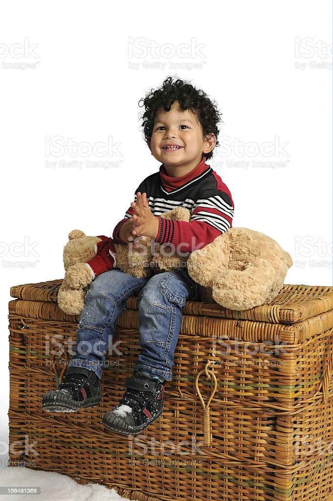 little boy seated on a big basket royalty-free stock photo