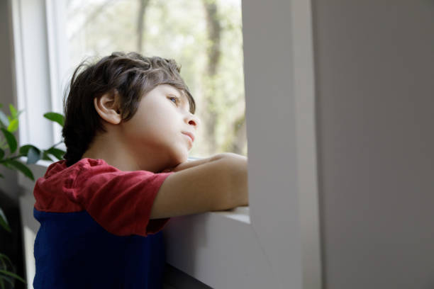 Little Boy Self-Isolation At Home stock photo