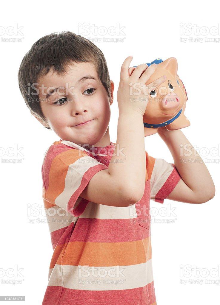 Kleine Junge schütteln Das Sparschwein – Foto