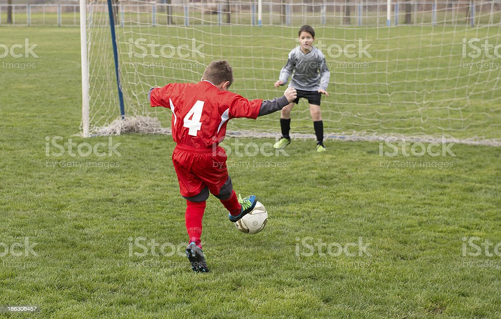 Little Boy Shooting at Goal royalty-free stock photo