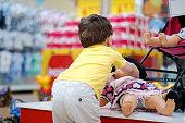 Little Boy Shopper in Supermarket