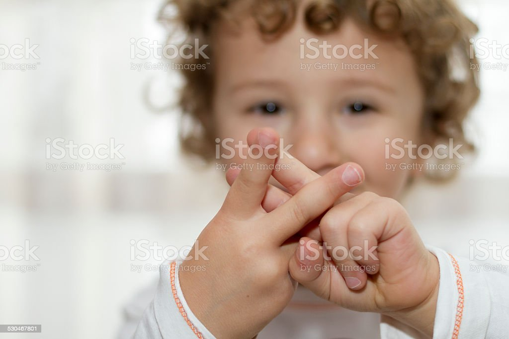 Little boy showing Hashtag sign stock photo