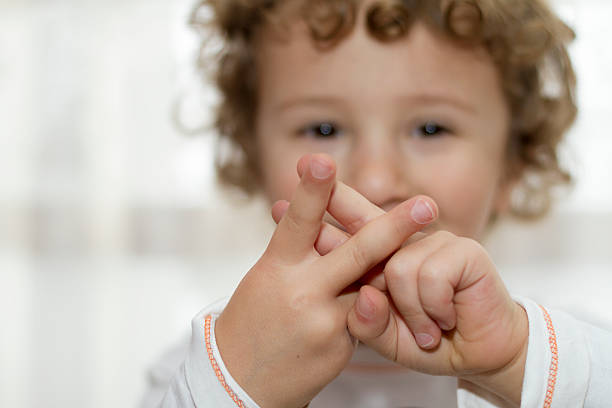 little boy showing hashtag sign - sign language stock photos and pictures