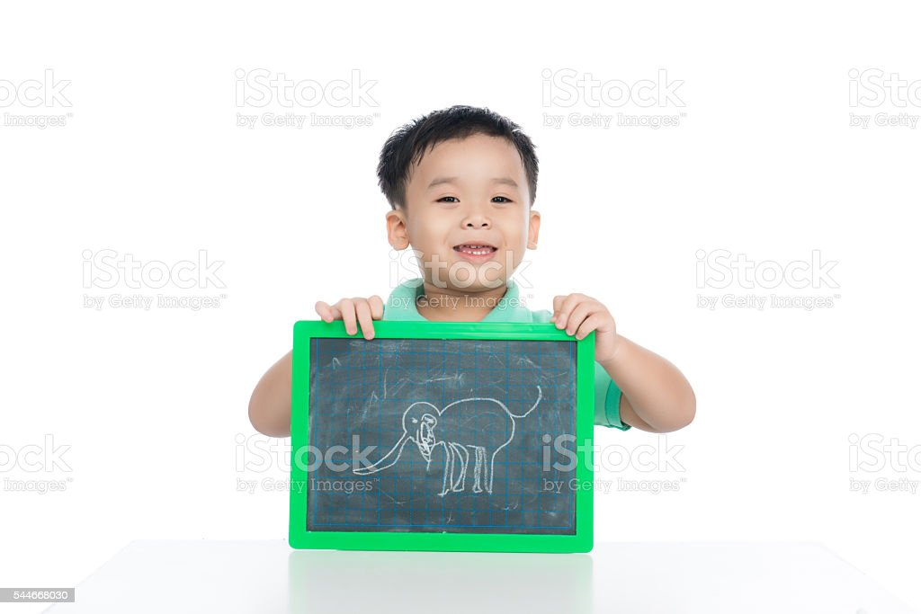 Little boy showing his drawing picture on blackboard stock photo