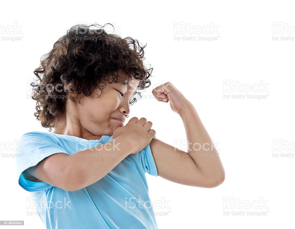 Little boy showing his muscles stock photo