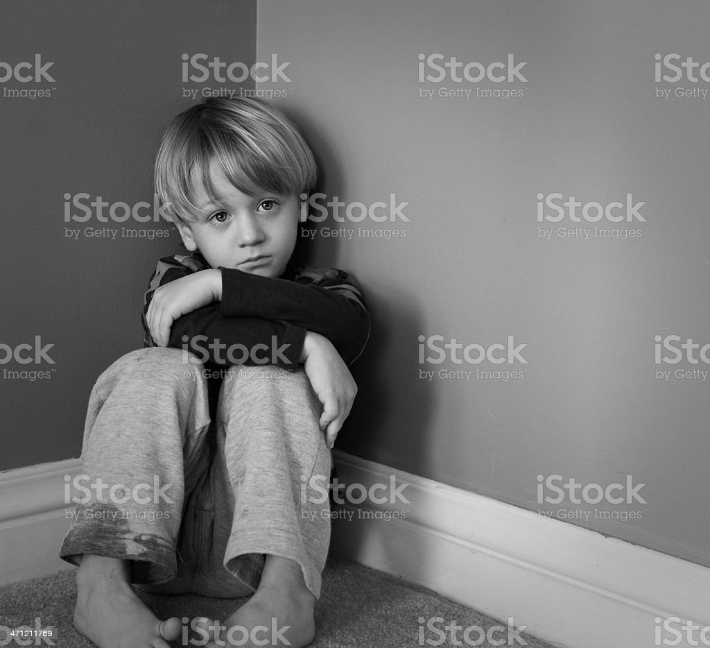 Little Boy Sitting in Corner Pouting royalty-free stock photo