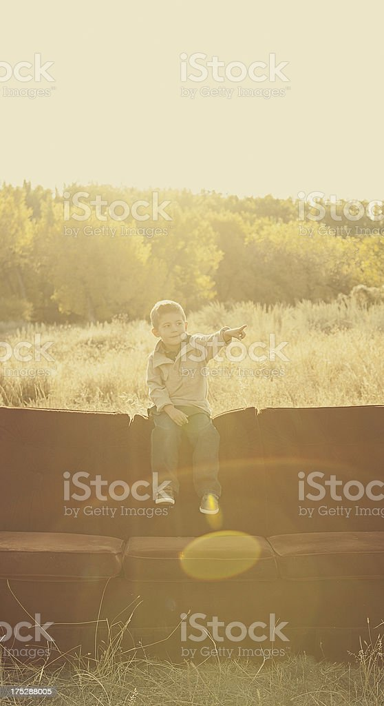 Little Boy Sitting on a Couch royalty-free stock photo