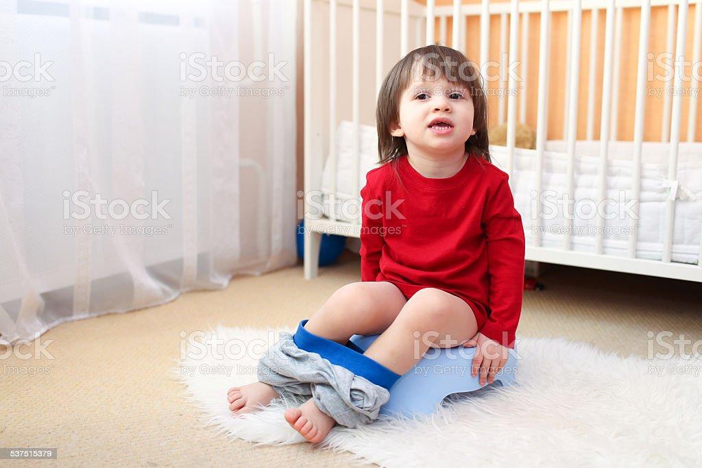 Caucasian Little Boy Sitting Straight On Chair Stock Photo
