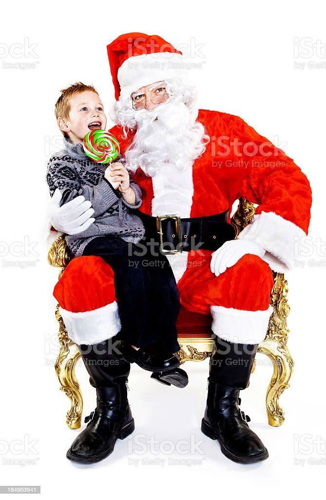 Little Boy Sitting on Santa's Lap stock photo