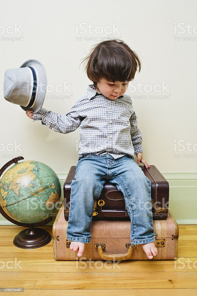 Little boy sitting on suitcases royalty-free stock photo