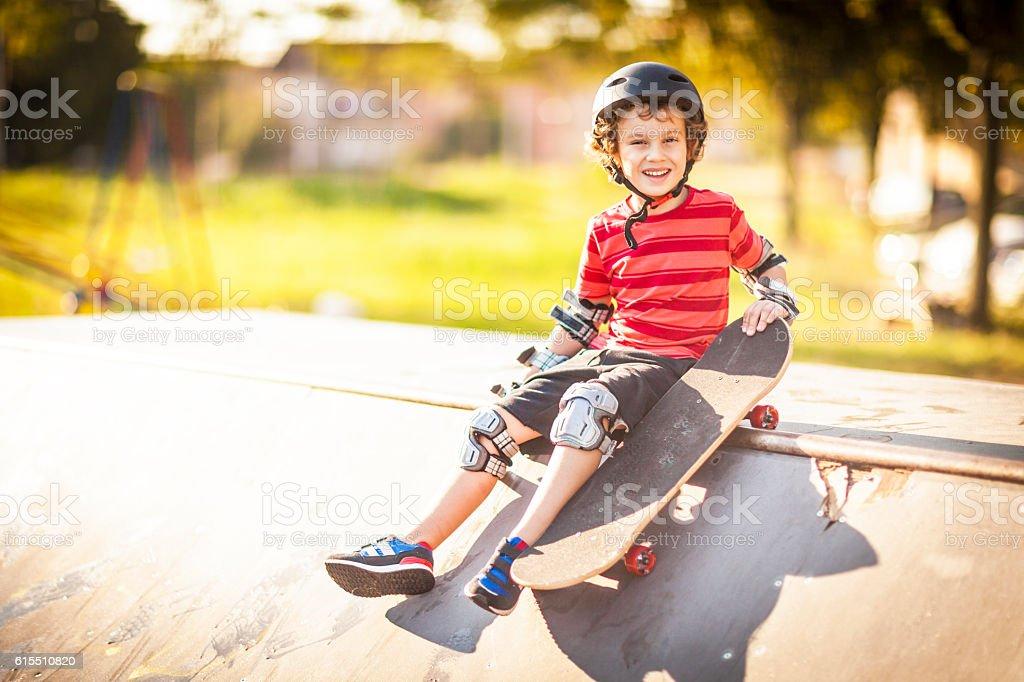 Little boy skateboarding stock photo