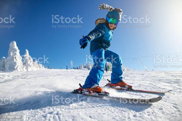 Little boy skiing on a beautiful winter day picture id1125637931?b=1&k=6&m=1125637931&s=612x612&h=mnvaecikgwpgxqkoofpww5 g xn2jkcghav7hkzfa k=