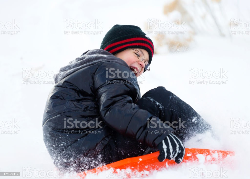 Little Boy Sledding royalty-free stock photo