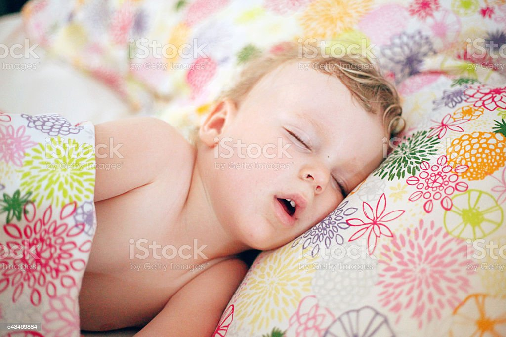 Little boy sleeping in the big bed stock photo
