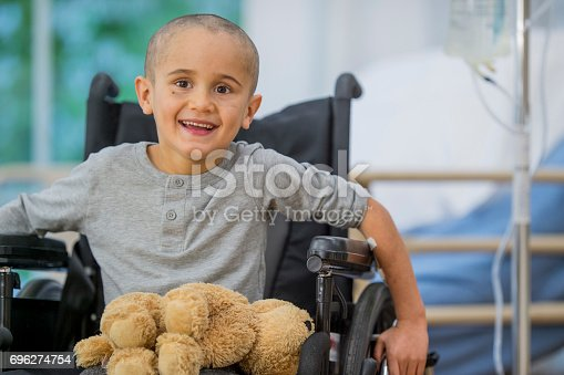 istock Little Boy Smiles and Learns to Move Again 696274754