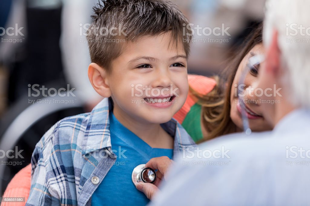 Little boy smiles during well check stock photo