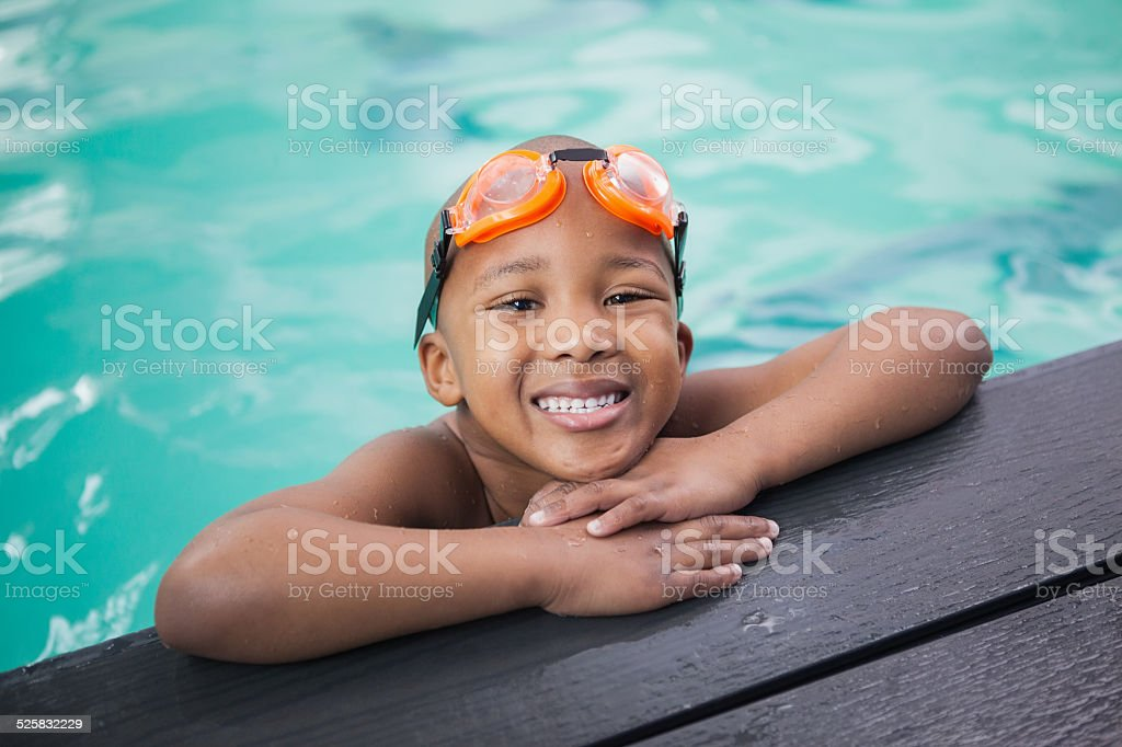 Little boy smiling in the pool stock photo
