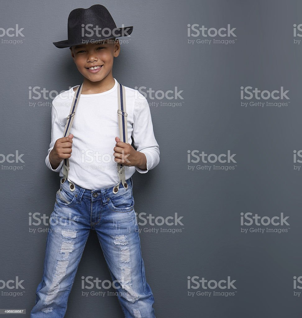 Little boy smiling with black hat and suspenders stock photo