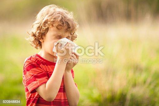 istock Little boy sneezing 520948834