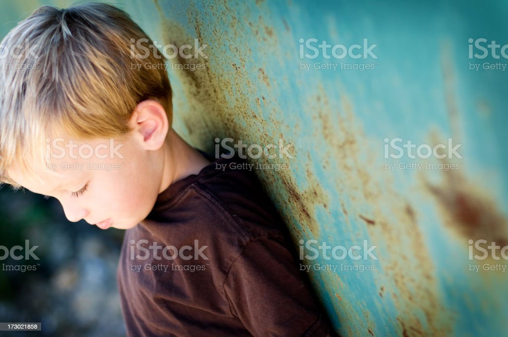Little boy standing against a rusty blue wall - Royalty-free Boys Stock Photo
