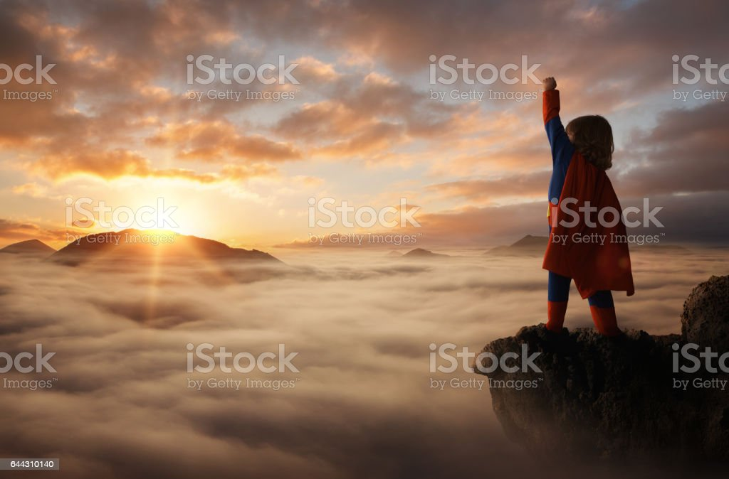 Little boy superhero stock photo